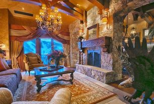 Eclectic Living Room with High ceiling, stone fireplace, French doors, Hardwood floors, Concrete tile , Wall sconce