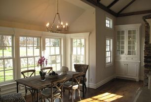Traditional Dining Room with Exposed beam, Hardwood floors, Built-in bookshelf, Chandelier, High ceiling