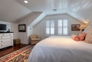 Cottage Master Bedroom with Hardwood floors, Hunter douglas newstyle hybrid shutters, Ikea Valby Ruta Rug