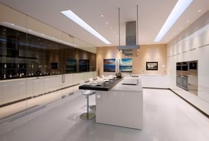 Contemporary Kitchen with Breakfast bar, Flush, Concrete tile , Standard height, Multiple Sinks, Island Hood, can lights