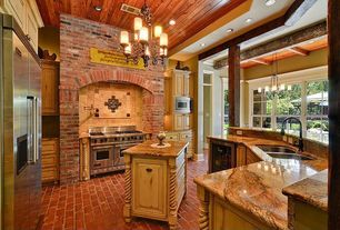Country Kitchen with High ceiling, Kitchen island, Custom hood, Raised panel, Stone Tile, U-shaped, Brick floors, Chandelier