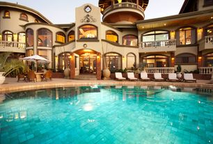 Mediterranean Swimming Pool with exterior stone floors, French doors, Crate & barrel regatta chaise lounge, Curved balcony