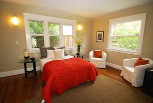 Modern Guest Bedroom with Hardwood floors, Wall sconce