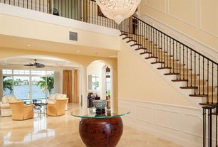 Traditional Entryway with Wainscotting, Standard height, simple marble floors, Chandelier