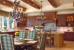 Traditional Kitchen with Breakfast bar, Breakfast nook, Glass panel, Raised panel, U-shaped, Undermount sink, Stone Tile