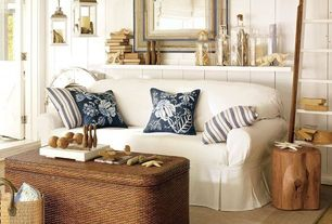 Cottage Living Room with Antique white wooden lantern candle holder, Natural tree stump side table, Hjalmaren wall shelf