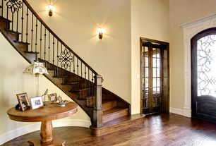 Traditional Entryway with Hardwood floors, French doors, Universal Cordevalle Vintage Round Pedestal Table, Glass panel door