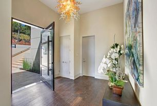 Contemporary Entryway with High ceiling, specialty door, Hardwood floors, French doors, Chandelier