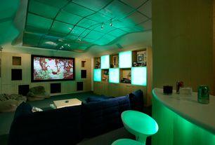 Modern Home Theater with Standard height, Carpet, Built-in bookshelf, Pendant light