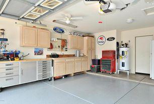 Transitional Garage with complex granite tile floors, flush light, Built-in bookshelf, simple granite tile floors