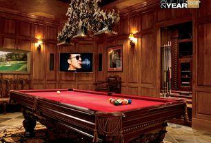 Craftsman Game Room with Built-in bookshelf, Pendant light, Wall sconce, Standard height, slate tile floors, Crown molding