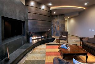 Contemporary Living Room with Pental indian autumn slate, stone fireplace, Cove lighting, High ceiling, Rolled steel wall
