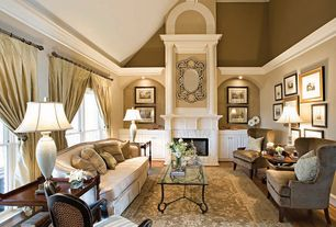 Traditional Living Room with Fireplace, Paint 1, can lights, Ceiling fan, Hardwood floors, Homeware Rizzo Chair, Area rug