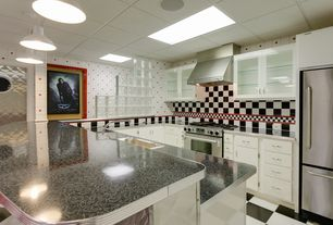 Eclectic Kitchen with Large Ceramic Tile, Pendant light, Vinyl floors, Formica counters, L-shaped, High ceiling, Skylight