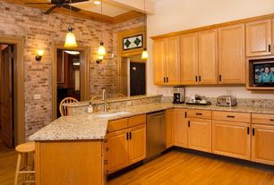 Traditional Kitchen with Breakfast bar, Raised panel, Hardwood floors, Complex granite counters, Complex Granite, Wall sconce