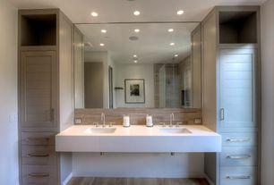 Contemporary Full Bathroom with Corian counters, Flat panel cabinets, Rain shower, European Cabinets, Hardwood floors, Flush