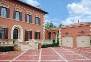 Mediterranean Garage with Brick floors, High ceiling, Wall sconce, Barn door, French doors