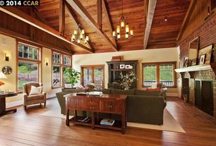Craftsman Living Room with Carpet, interior brick, Exposed beam, Hardwood floors, Chandelier, flush light, High ceiling