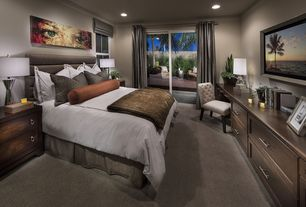 Contemporary Master Bedroom with Custom button-tufted side chair, Carpet, Crown molding, Built-in bookshelf