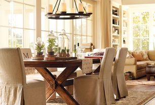 Eclectic Dining Room with Standard height, picture window, Hardwood floors, Exposed beam