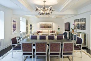 Contemporary Dining Room with Hardwood floors, Chandelier, Textured area rug, Ebony stain hardwood floors, Crown molding