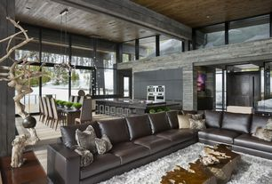 Contemporary Great Room with French doors, picture window, Custom tree stump coffee table, can lights, interior brick