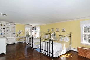 Country Guest Bedroom with Crown molding, Hardwood floors