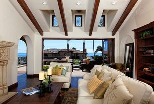 Contemporary Living Room with Hardwood floors, Pottery Barn Upholstered Carlisle Armchair, Exposed beam, Skylight