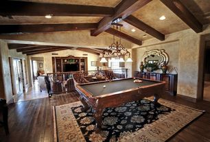Rustic Game Room with Exposed beam, Hardwood floors, Carpet, Standard height, Chandelier, French doors, Casement, can lights