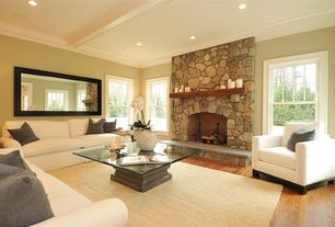 Contemporary Living Room with Hardwood floors, Pottery Barn Heathered Chenille Jute Rug, stone fireplace, Box ceiling