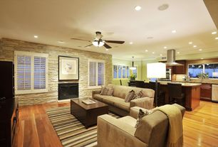 Contemporary Living Room with Ceiling fan, Hardwood floors, angelo:HOME Madison Square Green/Yellow Area Rug, metal fireplace