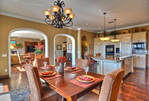 Eclectic Dining Room with Pendant light, Chandelier, Standard height, can lights, Crown molding, Hardwood floors