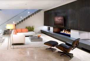 Contemporary Living Room with sandstone floors, insert fireplace, Fireplace, Standard height, can lights