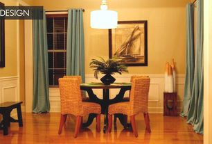 Tropical Dining Room with Chair rail, Wainscotting, Laminate floors, flush light