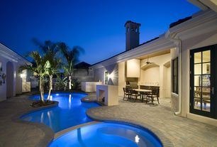 Tropical Swimming Pool with exterior brick floors, Fence, Casement, Pool with hot tub, Outdoor kitchen, French doors