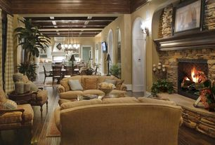 Traditional Great Room with Box ceiling, Hardwood floors, stone fireplace, Standard height, Wall sconce, Casement, Chandelier