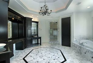 Traditional Master Bathroom with Soapstone counters, Flush, Chandelier, drop in bathtub, can lights, Bathtub, Vessel sink