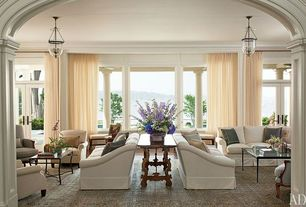 Traditional Living Room with Hardwood floors, Transom window, Restoration Hardware Camelback Slipcovered Sofa, French doors