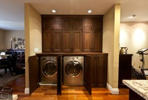 Traditional Laundry Room with laundry sink, Standard height, can lights, Paint, Hardwood floors, drop-in sink