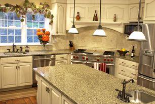 Traditional Kitchen with Flush, Custom hood, Kitchen island, L-shaped, Hardwood floors, Antique Bronze 1-light Mini-Pendant