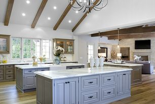 Country Kitchen with two dishwashers, Exposed beam, Farmhouse sink, Kitchen island, Hardwood floors, Chandelier, Casement
