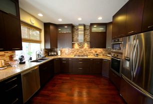 Modern Kitchen with Granite countertop, U-shaped, Malaccan cabernet, click lock hardwood flooring, Ceramic Tile, Glass panel