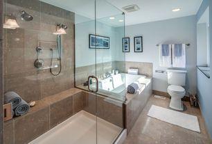 Contemporary Full Bathroom with Ms International Sea Grass Limestone, frameless showerdoor, Handheld showerhead, Wall sconce