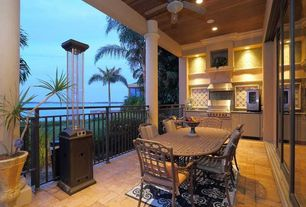 Tropical Porch with exterior stone floors, Wrap around porch, Outdoor kitchen