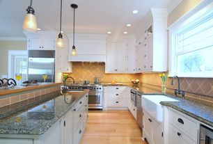 Traditional Kitchen with Crown molding, L-shaped, Complex granite counters, Pendant light, Travertine Tile, Kitchen island