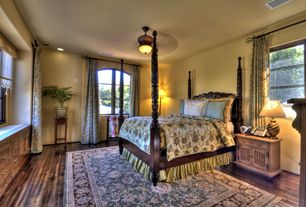 Mediterranean Guest Bedroom with flush light, Ceiling fan, Hardwood floors, Built-in bookshelf