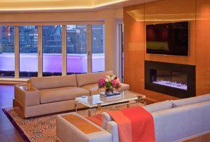 Modern Living Room with Dusk Wall-Mounted Electric Fireplace, stone fireplace, Hardwood floors, Jackson One Arm Sofa, Paint