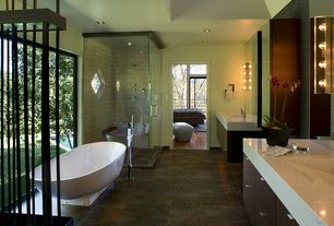 Contemporary Master Bathroom with Quartz countertop, Handheld showerhead, Winifred Freestanding Resin Tub, European Cabinets