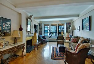 Traditional Living Room with Crown molding, Built-in bookshelf, Window seat, Hardwood floors, stone fireplace