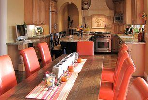 Mediterranean Kitchen with Flat panel cabinets, Kitchen island, Farmhouse sink, Ms international african rainbow granite